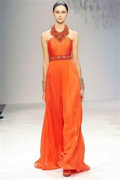 I like this orange dress Loving the necklace.