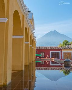 The most attractive public laundry we've ever seen!  Tanque de la Unión continues the elegant arches in soft yellow that distinguish the colonial city of Antigua. Volcán Agua looms in the background. . . . #antigua #visitguatemala #guatemala #tanquedelaunion #unesco #lifeofadventure #colonialcity #natgeovisual #iconicbuilding #bbctravel #guardiantravelsnaps #mylpguide #lpfanphoto #lifesabeach #natgeo #Travel #TravelBlogger #TravelPhotography #TravelDiary #TravelLife #TravelPics #TravelCouple…