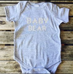 Your baby will love this super soft onesie Featuring the Popular Baby bear print A super cute match to your mama bear hoodie the sizes are 6, 12, 18, 24 months