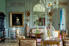 Central Salon - Resting beneath a mirror in the same room is a gilt-wood canapé that belonged to the 18th-century hostess Madame Geoffrin; the antique Sèvres statuettes depict literary figures.