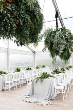 Inside an elegant wedding set at a Victorian homestead: The styling on the day focused on wild foliage and lighting, with the idea that the marquee tie in with the stunning surroundings.