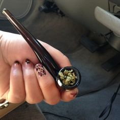 Leopard and flower nail art, with marijuana pipe. Chron bowl