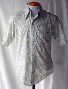 Men's 1970s Dannelli muted yellow and blue pattern short sleeve shirt with flower and vine design