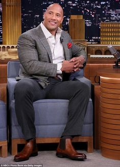 Clean up nicely: The former professional wrestler donned a white and grey striped dress shirt, blazer jacket and dark coloured trousers to talk about his latest TV show The Rock Dwayne Johnson, Rock Johnson, Dwayne The Rock, Dwane Johnson, Weightlifting Shirts, Sexy Military Men, Blazer Outfits Men, Blazer With Jeans, Blazer Jacket