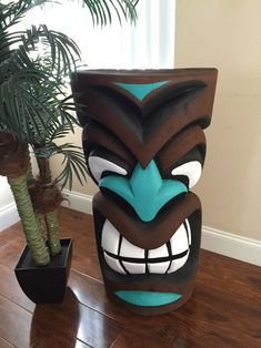 This is a Tiki statue hand carved painted from real palm tree. 3 foot tall by 18 wide this is a half tiki Tree Carving, Wood Carving Art, Wood Art, Pintura Tribal, Tiki Maske, Tiki Pole, Tiki Statues, Greek Statues, Buddha Statues