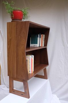for sale is a custom midcentury modern bookshelf made from solid wood