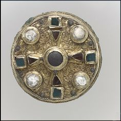 Disk Brooch, late 7th century. Frankish. Gold sheet with copper alloy backing and inlays of garnet, glass and calcite