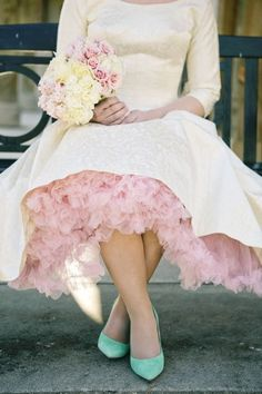 Retro Ruffles: Peek-a-boo! We see you, ruffles. From the top to the toes, everything about this look is put together perfectly. | Photo by Tiffany Hughes Photography | See more pretty pastels here: http://www.mywedding.com/articles/pastel-wedding-dresses/