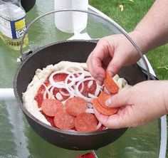 Photo: Dutch Oven Pizza - Step-by Step Photo Tutorial: http://whatscookingamerica.net/Information/DutchOven/Pizza/DutchOvenPizza.htm
