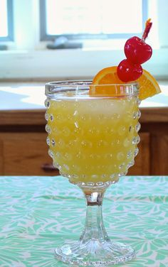 Fuzzy Navel •Peach Schnapps •Orange Juice  Fill an 8-oz glass with ice cubes.  Add a generous shot of Peach Schnapps.  Fill with orange juice.  Stir.  Garnish with an orange slice and maraschino cherry. The recipe is under this pin, on the blog. Enjoy!