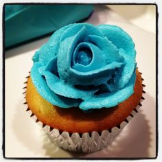 Tea party cupcake with a piped rose