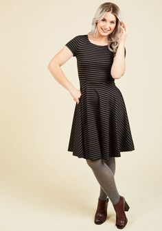 Compiling lists of swingin' tunes is your vocation, and in this black dress - a ModCloth exclusive - you create an audio-visual experience like no other. Darted at the bust and striped with classic white lines, this ponte knit frock is superbly cool - a great thing, because your track sequence is so hot!