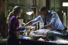 "Arrow -- ""The Odyssey"" -- Image AR114a_7398b -- Pictured (L-R): Emily Bett Rickards as Felicity Smoak, Stephen Amell as Oliver Queen, and David Ramsey as John Diggle -- Photo: Jack Rowand/The CW -- © 2013 The CW Network. All Rights Reserved."