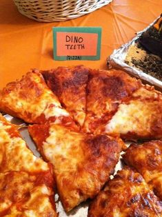 "Dinosaur birthday party food. Pizza cut into dinosaur ""teeth"""