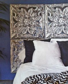 tin ceiling tile headboard, yes puhlease. fuck that chevron shit though.
