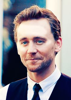Tom Hiddleston with his beautiful eyes twinkling as he smiles. He looks...so English in this picture.