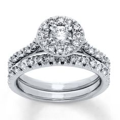 Round diamonds create a halo around a dazzling round diamond in her engagement ring as part of this elegant bridal set. Additional round diamonds adorn the bands of the engagement ring and the matching wedding band. Styled in 14K white gold, this bridal set has a total diamond weight of 5/8 carat. Diamond Total Carat Weight may range from .58 - .68 carats.