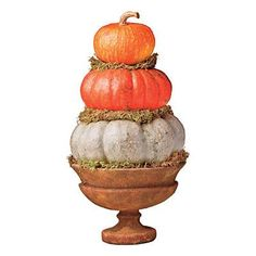 Gather Pumpkins | Create a pumpkin stack with dry sphagnum moss and three pumpkins in your favorite colors and in graduated sizes. | SouthernLiving.com
