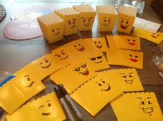 Draw Lego faces on small popcorn boxes to make party favor containers