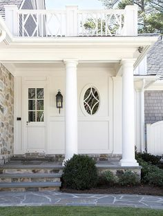 Like the color of the stones on the ground, porch, and wall of the house. Also love how  a different stone is used on the stair risers.