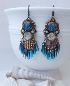Beaded earrings, it's called Blue Silk Earrings because the daggers have a silk effect for me. #earrings #blueearrings #blue #beadedearrings #beadembroidery #accessoriesoftheday #fashionista #summerfashion