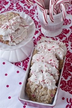 Oatmeal Peppermint Dipped Cookies!  After they cool, melt some white chocolate, almond bark or Wilton Vanilla Chips and dip one end of the cookie into the chocolate about 1/3 of the way.  Lay on a parchment lined cookie sheet and sprinkle with crushed candy cane.  Allow to set up.