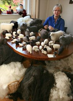 I love this picture of all her needle felted sheep. All sizes and colors.