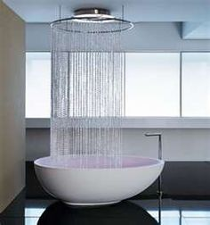 AMAZING shower head~ cute with scuptural modern tub