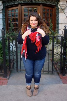 Never letting go of this holiday look with my favorite navy blue cable knit sweater and plaid fringe scarf!