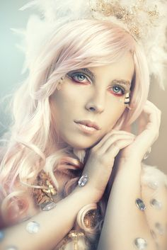 "Crystal and glitter accented Angelic orange, gold and feather make-up. ""Angel eyes"" by Rebeca Saray on deviantART."