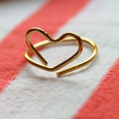 """This is a D.Y.I. heart ring that's supposed to be for the middle of your finger. It's also known as a """"midi"""" ring. I will add a small bead to each end so that I won't get the ring caught on my clothes."""