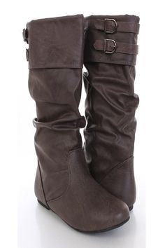Make a fashion statement with these boots! They will look super hot paired with your favorite skinnies or dress. Make sure you add these to your closet, it definitely is a must have! The features include faux leather upper with slouchy design, top strapped design with buckle accents, round closed toe, slip on design, smooth lining, and cushioned footbed. Approximately 15 inch circumference, and 11 inch shaft.