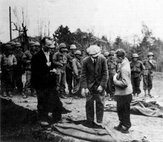 Buchenwald death camp, Germany, 1945, American soldiers forcing the local residents forced to bury the dead.