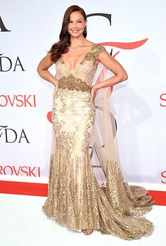 Ashley Judd channeled her inner goddess in a nude dress with golden embellishments, complete with a sheer cape.