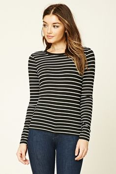 A ribbed knit top featuring an allover horizontal stripe pattern, long sleeves, and a round neckline.