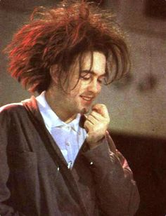 Robert Smith in a sweater...
