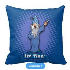 One bossy Wizard on a beautiful blue cushion.