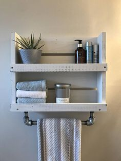 Beautiful handmade rustic white distressed wood bathroom shelf organizer with galvanized pipe towel bar. Add a warm rustic touch and keep your bathroom organized with our handmade shelf. The shelf is stained in a warm Walnut stain and then hand painted with a white chalkboard paint