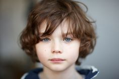 cute young boy with reddish hair and blue eyes