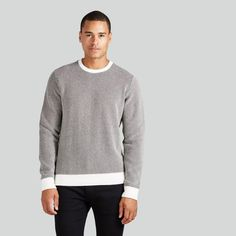 The key to true style can often be found in how you master accents. Let this Chunky Crewneck Fleece sweater in mixed black master it for you, with its white bands on its bottom, sleeves, and collar. $65