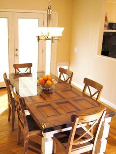 Build a table from an old door and posts! I have this same door and want to replace it! Now I know what I can reuse it for.