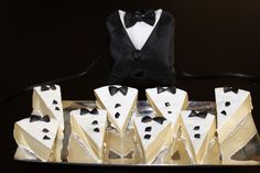 Add decorations to look like tuxedos to the top of cheesecake slices for New Year's retro styling.