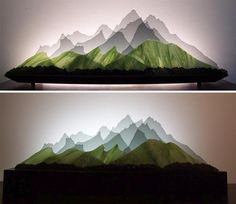 Rearrangeable Layers of Glass Form Spectacular 3D Landscapes and Seascapes