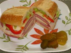 Super Italian Sub. Sandwich big enough to feed a crowd. You can make this up to 24 hours ahead, and just unwrap, slice and enjoy. Perfect for picnics.