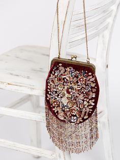 Luella Crossbody   Vintage inspired dainty velvet crossbody featuring bead embellishments and statement fringe. Metal chain strap.