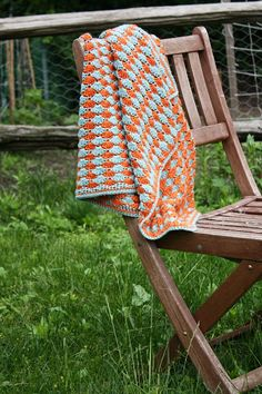 The link to the pattern for this gorgeous tangerine and seafoam blanket is posted on the site.