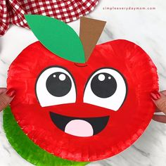 This paper plate apple is a fun fall craft for kids! Let them paint a paper plate or use a red paper plate to skip that step. Download the free printable template and make with preschoolers, prek and kindergarten children.