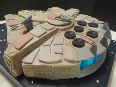 Millennium Falcon Cake.  To see a video go to: https://www.facebook.com/groups/gowilddesigns/