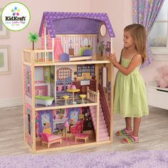 Amazon.com: KidKraft Kayla Dollhouse + 10 Pieces of Furniture She wants a doll house big enough for her barbies