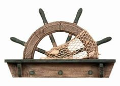 """Wooden Half Ship Wheel Shelf w/ Hooks by HS. $54.95. The wooden half ship wheel shelf w/ hooks measures 16"""" x 2"""" x 10.5"""".. There is fish netting with shells in it wrapped around the half ship wheel.. It will add a definite nautical touch to whatever room it is placed in and is a must have for those who appreciate high quality nautical decor. It makes a great gift and impressive decoration.. Below the half ship wheel there is a shelf.. Below the shelf there are three hook..."""